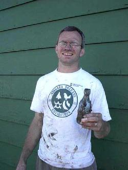 Author Peter Jabonski during one of his privy digs to unearth rare Buffalo beer bottles