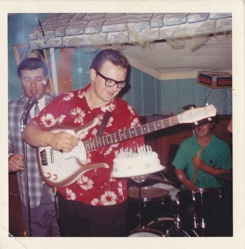 Eddie Blazonczyk receives a cake as Marion Lush sings Happy Birthday.