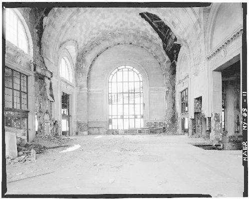 Interior of larger DL&W passenger building showing main concourse on upper level, with stairway from street level at right of photo and passage to trains at left. Skyway can be seen through large window facing Buffalo River. Matching window is directly opposite.