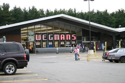 "The Wegman�s Fairport Road store can be classified as an example of �mid-century� modern architecture. They style is usually defined as buildings constructed between the mid-1950s through the late 1960s. Typical mid-century architecture features include abstract shapes and curves, innovative use of materials, and a sense of humor and optimism. People also refer to this period as ""googie"", ""jetset"", ""space age"", ""Jetsons"", ""populuxe"", etc."