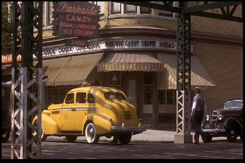 "Image from the film: Parkside Candies on Main Street. Note Chicago ""El"" structural supports (1983)"