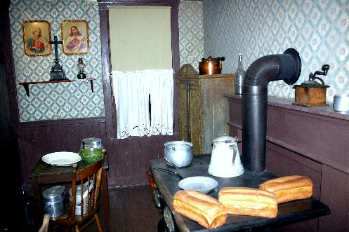 In Pittsburgh, the John Heinz History Center hosts a popular exhibit that allows visitors to walk through a home of a 1910 Polish steelworker. The exhibit features a poorly lit kitchen with simple furniture, religious icons and a large cast iron stove. Visiting the exhibit you truly feel part of the immigrant experience.